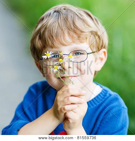 Funny Cute Kid Boy With Glasses Walking Happily In Field