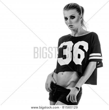 Beautiful young cheerleader in a uniform