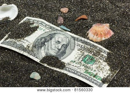 Image Of Hundred Dollar Banknote In Sand