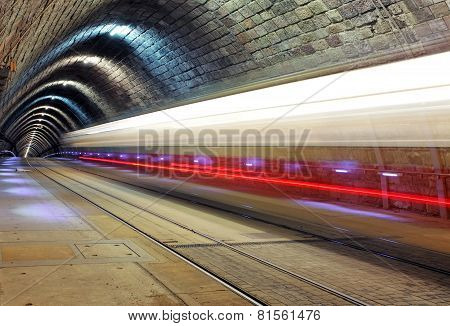 Train Disappearing Into A Tunnel