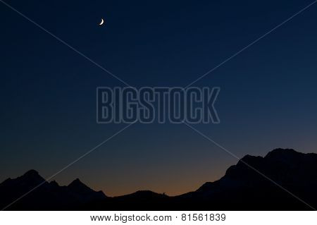 Moon Over Mountain Range At Night