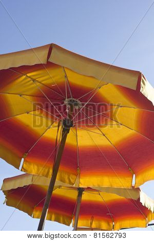 Red And Yellow Beach Umbrellas