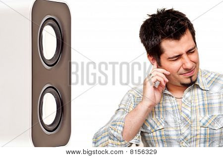 portrait of unhappy man pluging his ear from noise