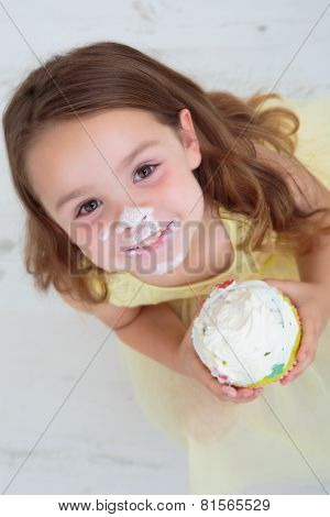 Child eating birthday cake
