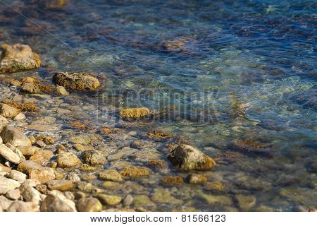The rocky coastline and rocks under the water