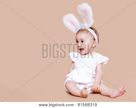 Cute Baby Sitting In Costume Easter Bunny