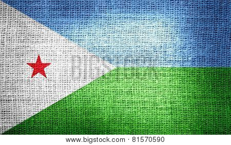 Djibouti flag on burlap fabric