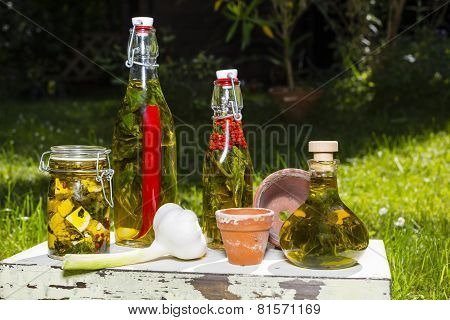 Garlic Bulb And Olive Oil With Herbs