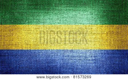 Gabon flag on burlap fabric