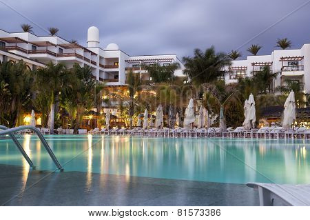 Hotel With Swimming Pool At Dusk