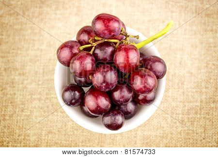 Grapes In Bowl On Hessian Burlap Background