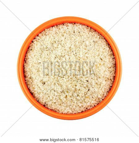 Orange Bowl Of Psyllium Husks Isolated On White Background