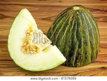 Rustic Gourmet Christmas Melon On Wooden Background