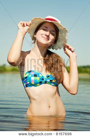 Teenage Girl Wearing Straw Hat