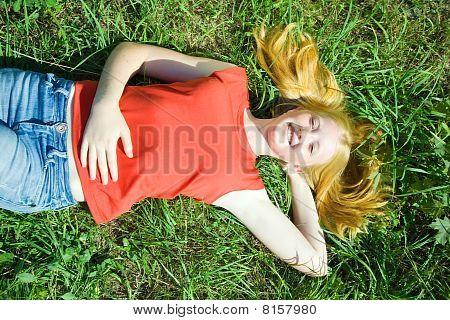 Teenager Girl Lying In Grass