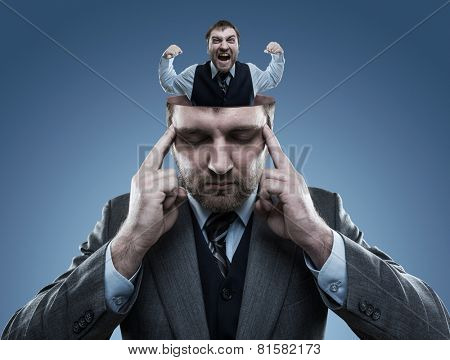Crazy man in the head of young businessman