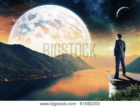 Businessman standing in the night