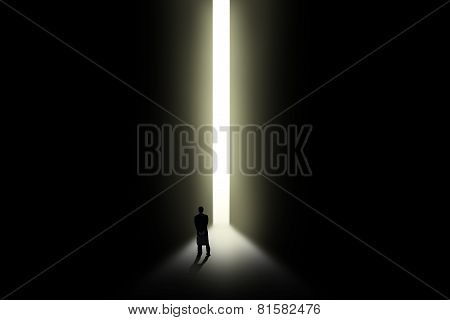Businessman Looking At Bright Light