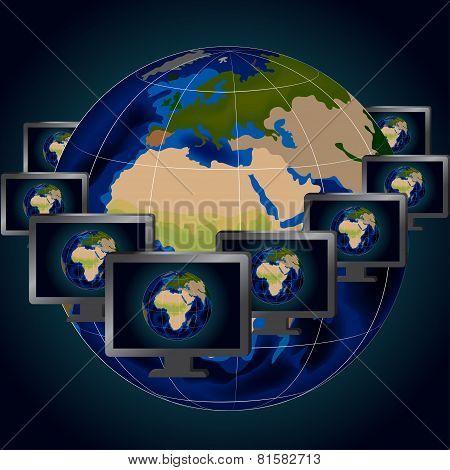 Several monitors and globe
