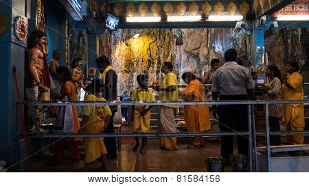 KUALA LUMPUR, MALAYSIA - JANUARY 31, 2015: Hindu devotees perform prayers at the Sri Mahamarriamman temple inside Batu Caves. Hundreds of thousands of devotees come here for the Thaipusam prayers.