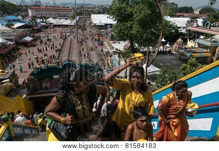 KUALA LUMPUR, MALAYSIA - JANUARY 31, 2015: Hindu devotees walk up the Sri Mahamarriamman temple built inside a limestone cave. Hundreds of thousands of devotees gather here for the Thaipusam prayers.