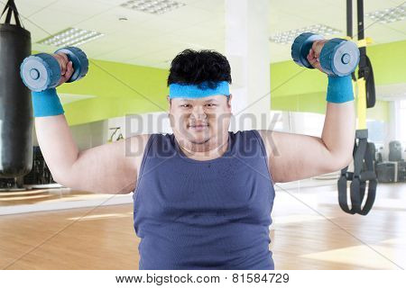 Fat Man Exercise In Fitness Center