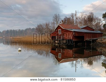 Red Boat House, Calm Sea