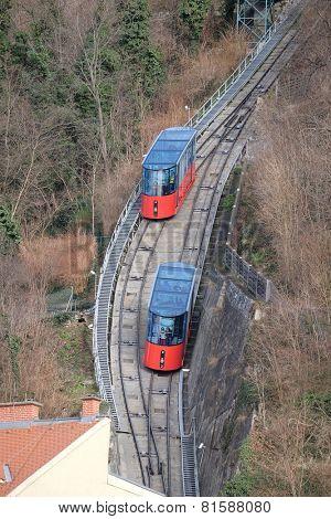 GRAZ, AUSTRIA - JANUARY 10, 2015: Modern funicular climbing to Schlossberg and Graz city panoramic view, Austria on January 10, 2015.