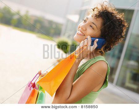 Hispanic Woman With Shopping Bags