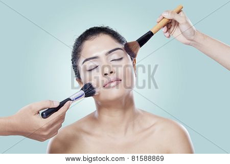 Woman With Makeup Artist Hands