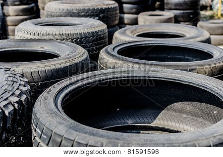 Stack Of Used Tries That From Truck And Cars