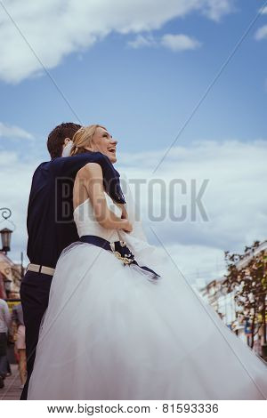 Newly Wed Couple Dancing Next To A Lake