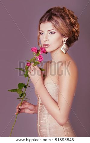 Studio Portrait Of A Beautiful Dark Blond Woman With Evening Hairdo And Makeup