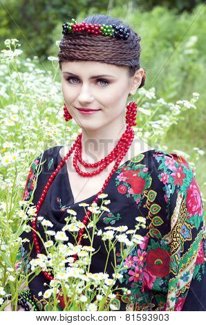 Happy Smiling Russian Woman Sitting In The Field