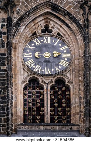Ancient Clock On The Facade Of The Main Entrance To The St. Vitus Cathedral In Prague