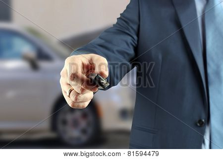 Young Successful Businessman Offering A Car Key.