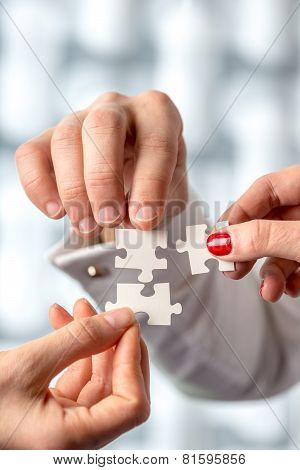 Conceptual Human Hand Holding Puzzle Pieces