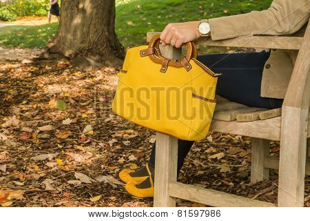 Woman holding yellow purse
