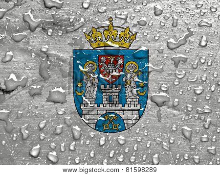 a flag of Poznan with rain drops