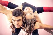 image of two women taking cell phone  - Sporty couple taking a picture in a fitness studio after gymnastics workout  - JPG
