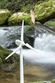 picture of generator  - Wind power generator model in front of brook  - JPG