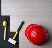 picture of laminate  - texture laminate tape measure and a hammer with a red helmet - JPG
