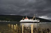 stock photo of bute  - Heavy sky over a car ferry on the Kyles of Bute - JPG