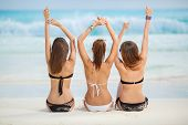 stock photo of woman bikini  - Three young girls with a nice figure - JPG