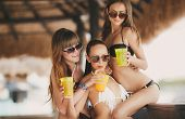 picture of hawaiian girl  - Three young girls with beautiful figure - JPG