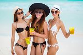 stock photo of hawaiian girl  - Three young girls with a nice figure - JPG