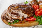 picture of roasted pork  - roasted pork shoulder on the bone with potatoes - JPG