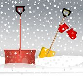 picture of snow shovel  - Shovels resting in the snow  - JPG
