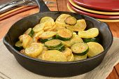 stock photo of sauteed  - Sauteed summer and zucchini squash in a cast iron skillet - JPG