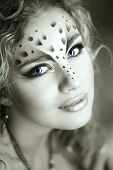 picture of panthera uncia  - Beauty woman with makeup in snow leopard style - JPG